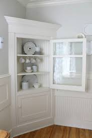 white wooden corner hutch with glass door for lovely home furniture ideas