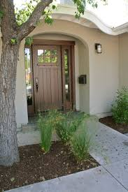 craftsman style decor entry with arched white chandeliers