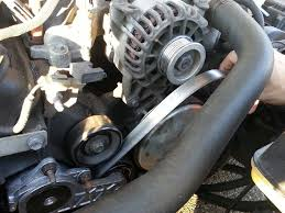 serpentine belt tensioner. hold the tensioner down and remove serpentine belt from over alternator pulley.
