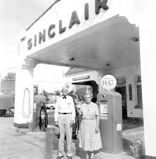 Florida Memory • Mr. and Mrs. Raymond Gregory, Sr., at their Sinclair  service station - Havana, Florida.