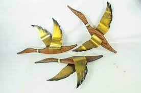 From photos of bufflehead ducks and redhead ducks to stylized images of ducks and photographs of mallards, you'll find a lovely flock of our fine, feathered friends. Set Of 3 Vintage Wall Decor Ducks Wood W Brass Wings 21 Wide Each Item 228 Look What I Found