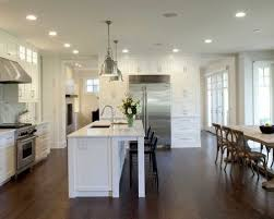 lighting over a kitchen island. Example Of A Classic Dark Wood Floor Eat-in Kitchen Design In Minneapolis With Stainless Lighting Over Island E