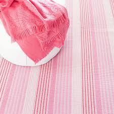 pink sand ticking woven cotton rug by dash albert