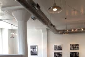 exposed lighting. exposed ductwork and industrial lights lighting x