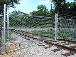 commercial chain link fence parts. Chain Link Fence Kits There Is A Galvanized Fabric Fencing Installed On Railway . Commercial Parts