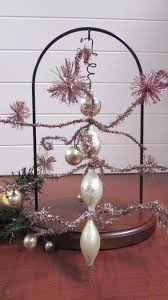 this beautiful mercury glass finial tree topper was made in romania by classics it has double bulbs plus a semi bulb at the top and it s