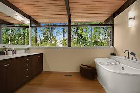 cool bathtub caddy in bathroom midcentury with midcentury modern sconce next to light wood ceiling alongside