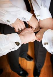 for our groomsmen we did geeky cufflinks geared to their interests they loved them