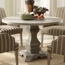 excellent brown stripes fabric dining chairs and grey wooden round pedestal standing dining table for your dining room