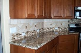 simple kitchen design with marble kitchen countertop and cream kitchen wall tile also wooden cabinet
