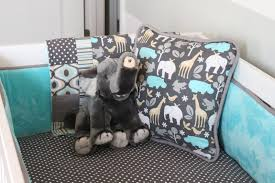 fascinating giraffe crib bedding with koala doll