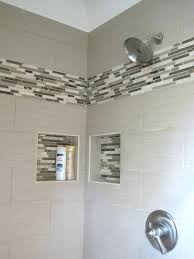 linen tile with glass linear mosaics to accent the shower space narrower band and diffe bathroom