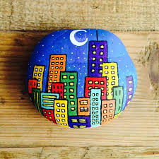 city skyline by night rock painting idea