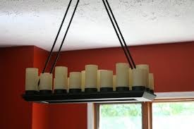 cool rectangle candle chandelier 1 engaging pillar rectangular 29 awesome chandeliers crystal black with and red wall