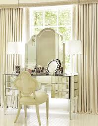 contemporary glass vanity table with drawer and makeup shelves built in with mirror and double white table lamp plus french style chair without arms