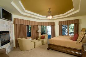 big master bedrooms couch bedroom fireplace: the wooden sleigh bed is polished to a glow the enclosed fireplace is set into