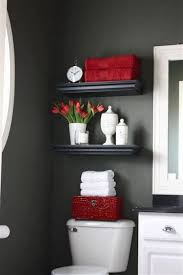 small bathroom clock:  ideas for small bathrooms black open shelving and flower vase and pottery and clock and tissue box