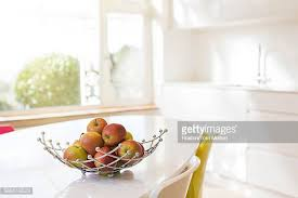 kitchen table with food. Apples In Wire Basket On Modern Kitchen Table With Food S