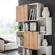view in gallery sliding doors of the bookshelf give it a dynamic appeal