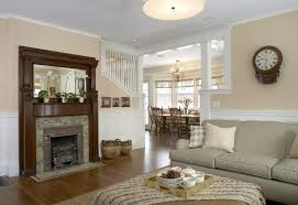 dark wood trim white walls family room traditional with fireplace mantel fireplace mantel tan wall