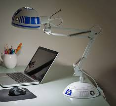 this architectural style desk lamp is made to look just like r2 d2 from star wars except you know in lamp form officially licensed from star wars and