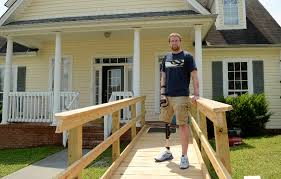 josh manning who lost a leg and suffered other injuries in a motorcycle crash in march stands on a new wheelchair ramp in front of his ooltewah home