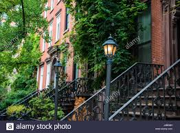 stock photo vintage lamp post near old apartment buildings in greenwich village new york city