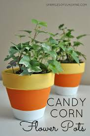decorate your home for fall easily with these simple diy candy corn painted flower pots