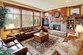 craftsman living room with metal fireplace hardwood floors pottery barn brandon rug