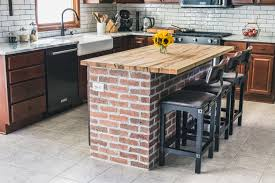 Diy kitchen island Board And Batten Kitchen Island With Exposed Brick And Wooden Countertop Jelly Toast Diy Brick Kitchen Island Behind The Scenes Of Our Kitchen