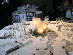 wedding round table centerpieces three frosted glass stand vases on large round table in table decorations