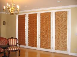 beige soft folded roman shades for white french patio doors and beautiful chandelier decor alluring wall sliding doors