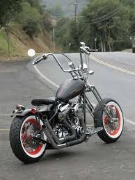 ape hanger handlebars and white wall tires motorcycles