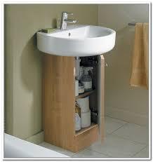 cute design of wooden pedestal sink storage idea to decorate narrow bathroom