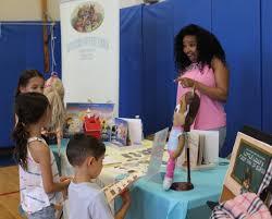 author kadeja wexler greets young readers at garden city park school s author s night photo by rebecca klar