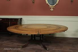 maitland smith leather top large round dining table with leaves of exceptional perimeter extensions