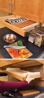This pull out drawer under kitchen cabinet is perfect for storing knives.  http:/