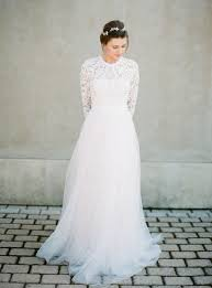 picture of modest wedding dress with a lace top and a tulle skirt