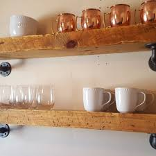3 thick solid wood shelves with pipe supports open