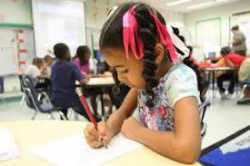 conscious classroom activities to awaken kids global awareness  child writing at school