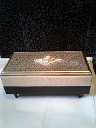 Miniature sankyo japan music box necklace pendant w/chain, works great. Sankyo Japan Musical Jewelry Box Gold Black Fleur De Lis Musical Jewelry Box Musical Jewelry Fleur De Lis