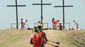 penitents walk towards crosses as they whip themselves on april 3 2016