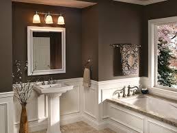 antique bathroom lighting. Vintage Bathroom Lighting In A With Mirror Underneath And Sink Plus Flower Vase Besides Bathtub Near Antique 0