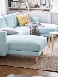 blue loveseat in white contemporary living room