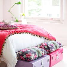 Make a feature of a girly bedroom storage solution