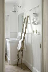 white beadboard bathroom. Beadboard Bathroom White Cottage Features Upper Walls Painted And Lower Clad In Trim