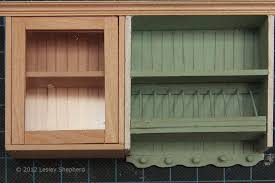 glass fronted upper cabinet with opening door for a dollhouse scale kitchen