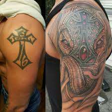 Cover Up Of Tribal Style Cross With Freehand Elephant By Louie Lopez