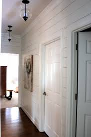 planked wall hallway gets new light fixtures