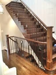 Modern style iron railing with clear glass inserts. Rift cut white oak was  used for